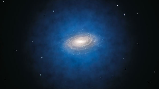Impresión artística de la esperada distribución de la materia oscura (coloreada en azul) alrededor de la Vía Láctea (en el centro). ESO/L. Calçada.