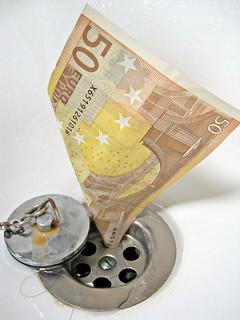 Malgastar dinero