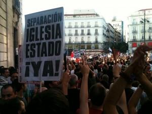 Cartel de una de las manifestaciones que tuvieron lugar en contra de la visita del papa a Madrid, en 2011. (El perroflautadigital / WIKIPEDIA)