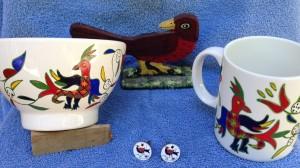Los colores y los pájaros de los amish y de los albercanos mantienen su parecido a través de siglos y océanos.