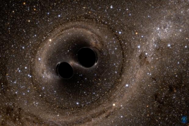 El sistema binario de agujeros negros, antes de la fusión. Imagen de MIT.