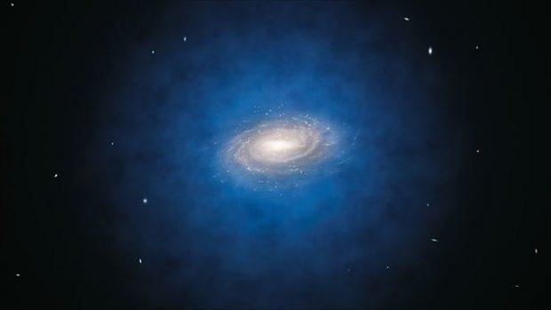 Representación hipotética de la distribución de materia oscura (nube azul) en la Vía Láctea. Imagen de ESO/L. Calçada vía Wikipedia.