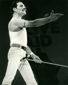 Freddy Mercury with Queen on stage at Live Aid on 13 July 1985 at Wembley Stadium, London.
