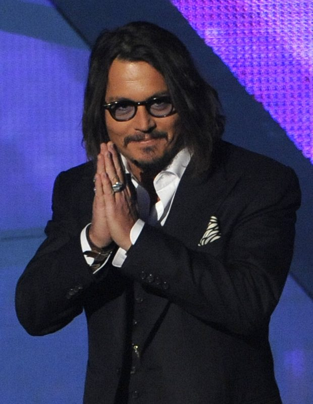 Actor Johnny Depp goes on stage to accept the award for favorite movie actor at the People's Choice Awards on Wednesday, Jan. 5, 2011, in Los Angeles.