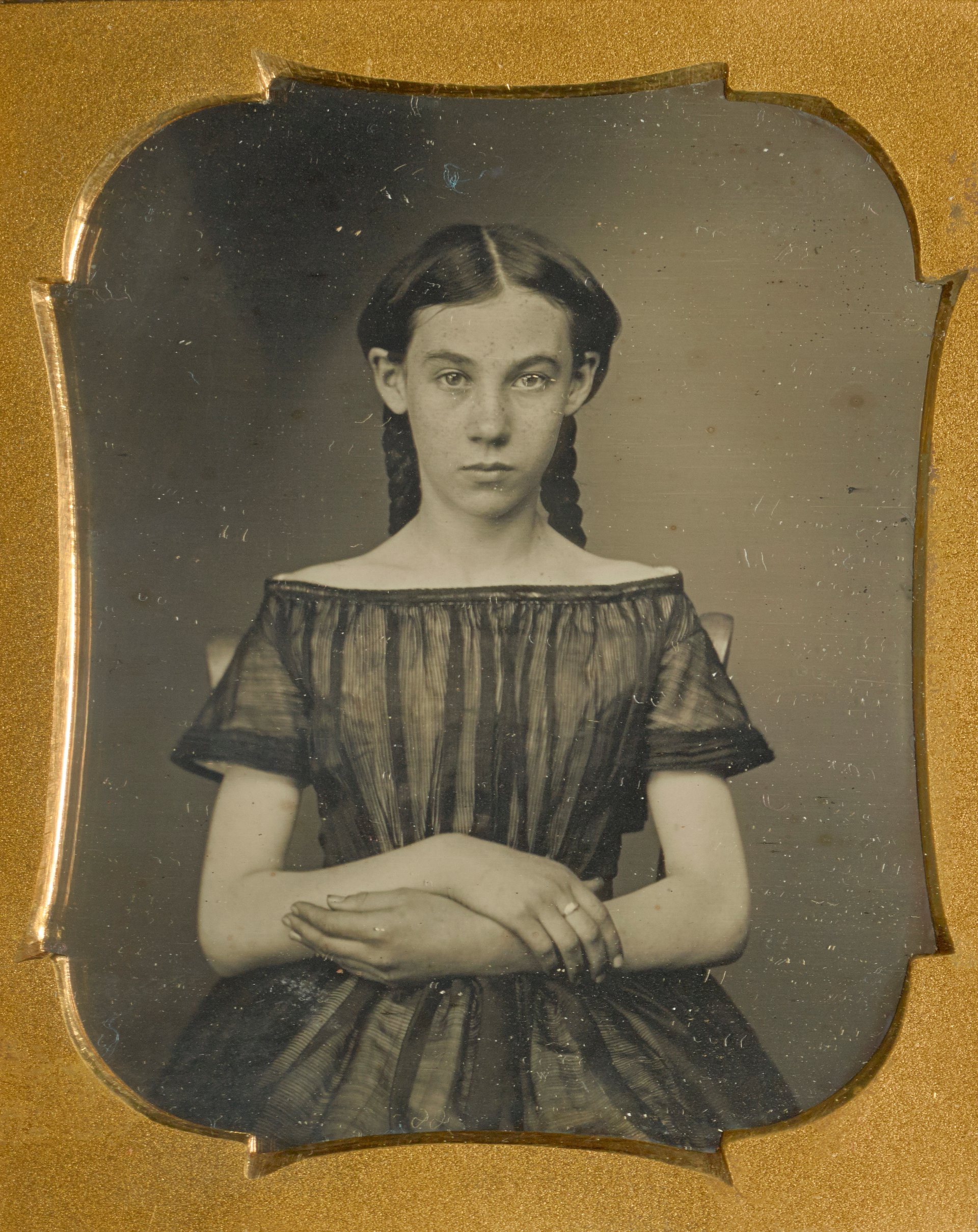 Portrait of a Seated Unknown US daguerreotypist - Girl, c .1850 © The J. Paul Getty Museum, Los Angeles