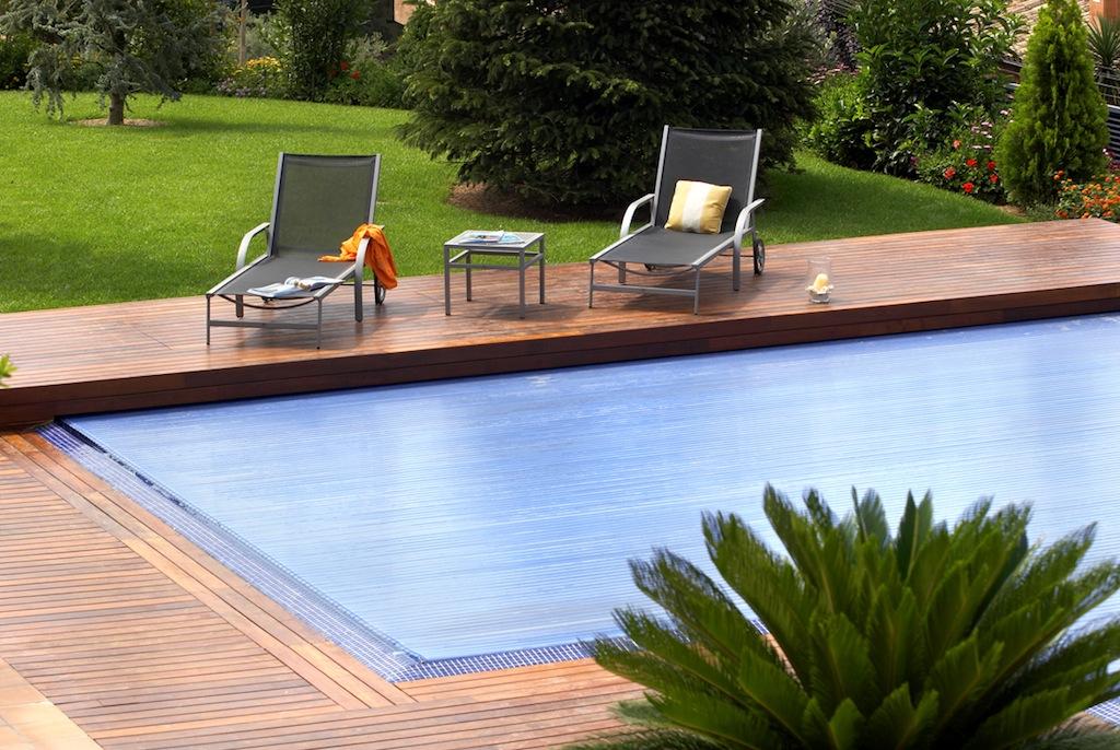 Piscina un hogar con mucho oficio for Como hacer un cubre piscinas