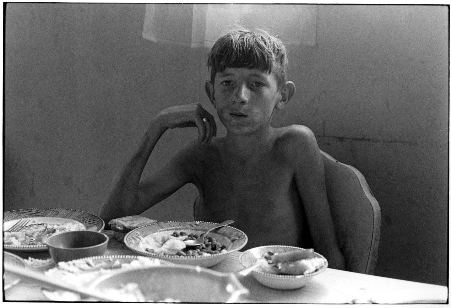 """Boy at dinner table"" - William Gedney, 1972"
