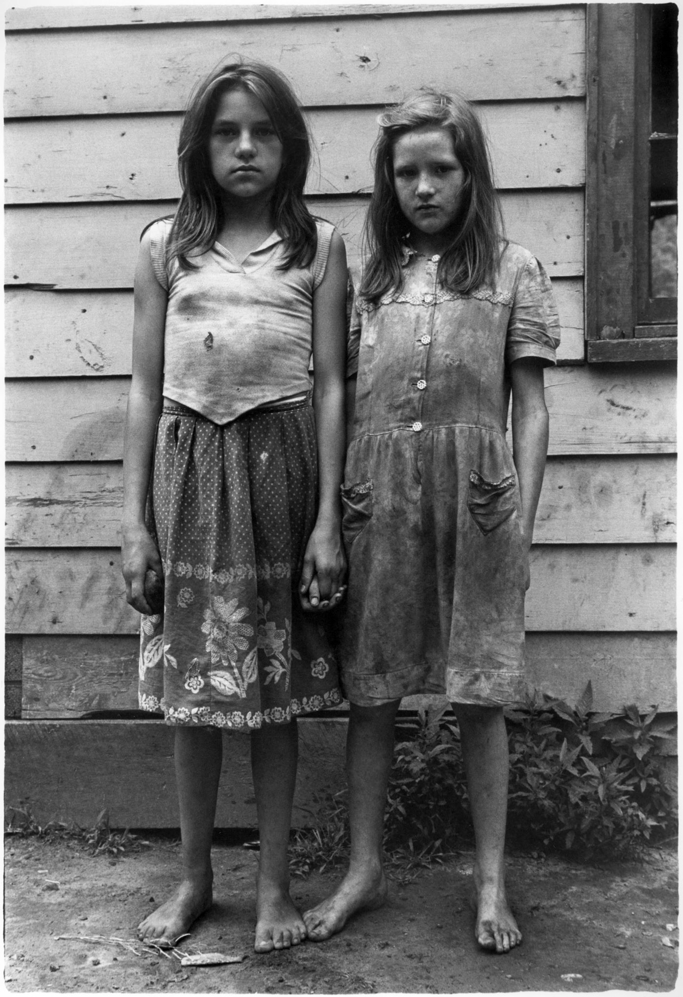 """Two girls with dirty clothes holding hands"" - William Gedney, 1964"