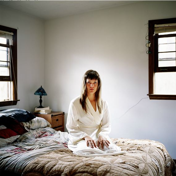 On bed, Kennesaw, Georgia, 2008 © Guillaume Simoneau