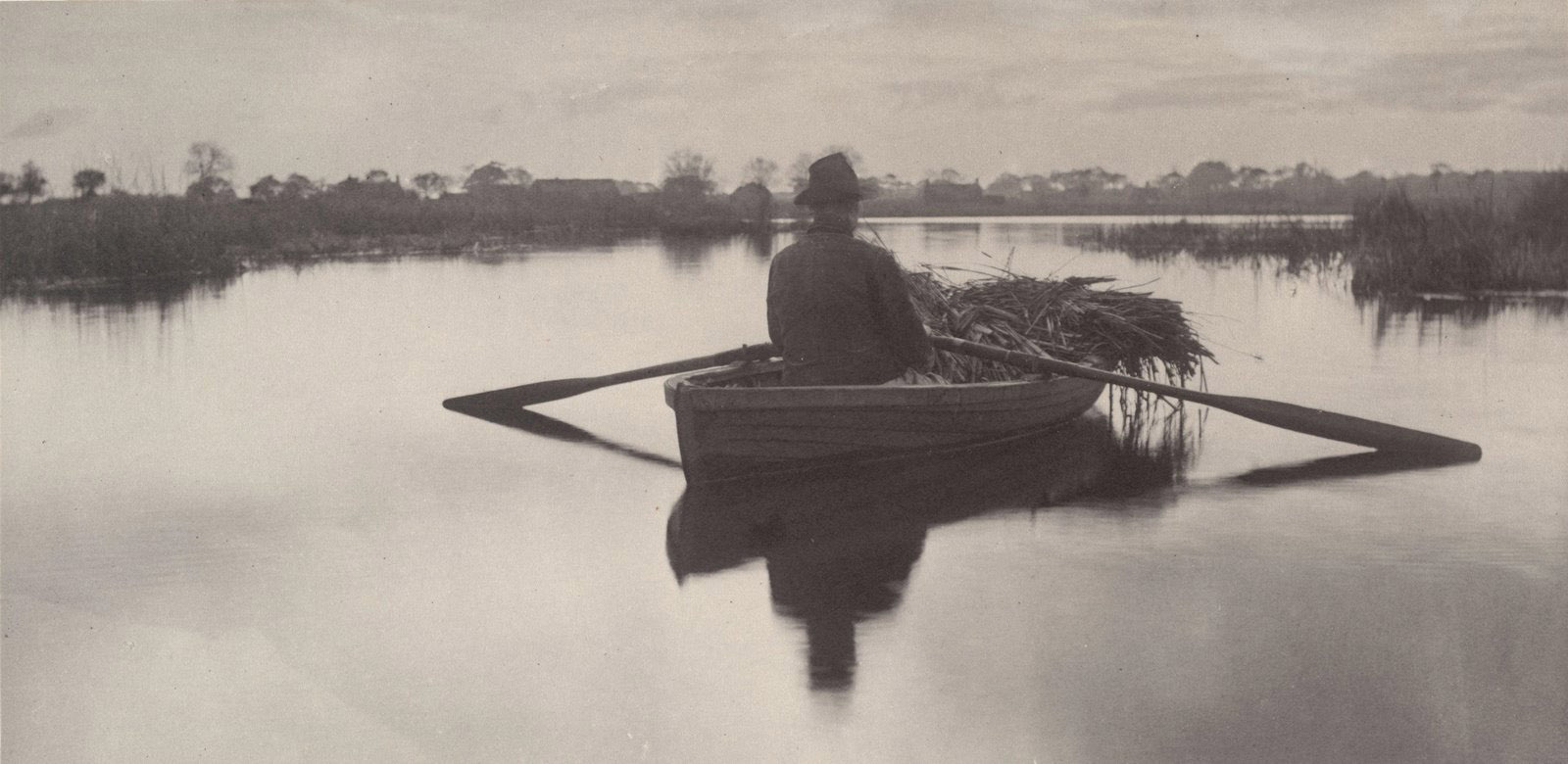 Peter Henry Emerson - Rowing home the Schoof-Stuff from Life and Landscape on the Norfolk Broads, 1886