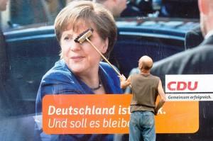 Cartel electoral alemán con Angela Merkel (EFE)