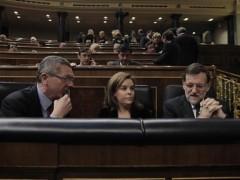 Gallardón, Sáenz de Santamaría y Rajoy, en el Congreso. (EP)