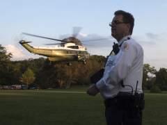 Un miembro del servicio secreto presta guardia en el Ala Sur de la Casa Blanca. (EFE)