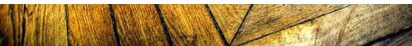 Cuidado al fregar tus suelos de madera: emplea productos apropiados y protégelos de agua y otros líquidos.