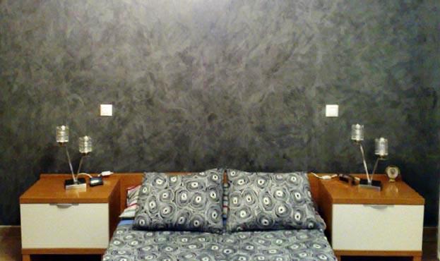 C mo conseguir el efecto estuco en las paredes de tu casa for Pintura efecto piedra
